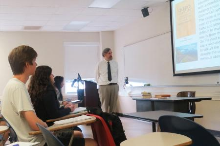 Summer Institute Director Dr. John Nicholson in classroom with students LATN 6050